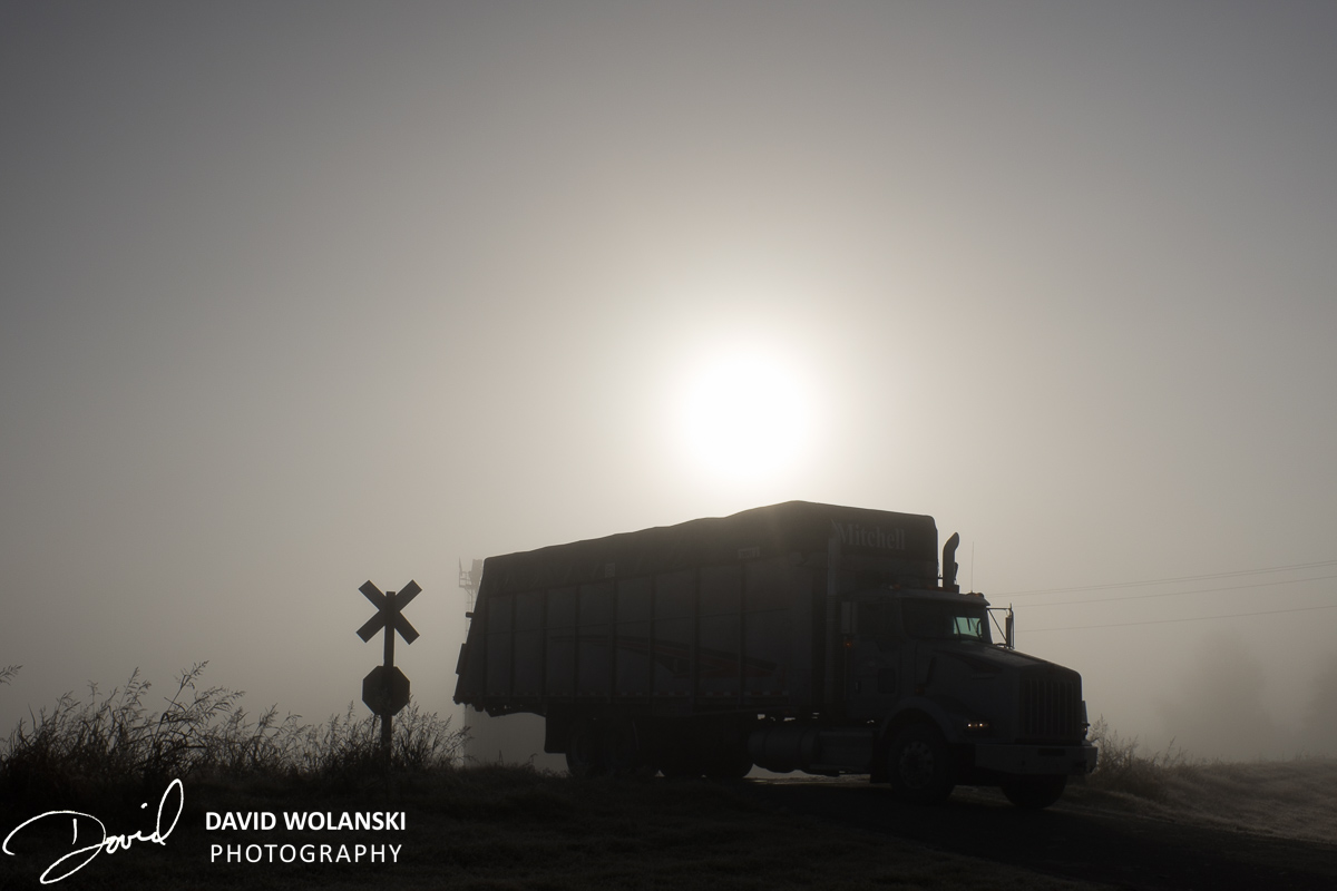 Truck going over railroad crossing in Fog near Clarksdale MS