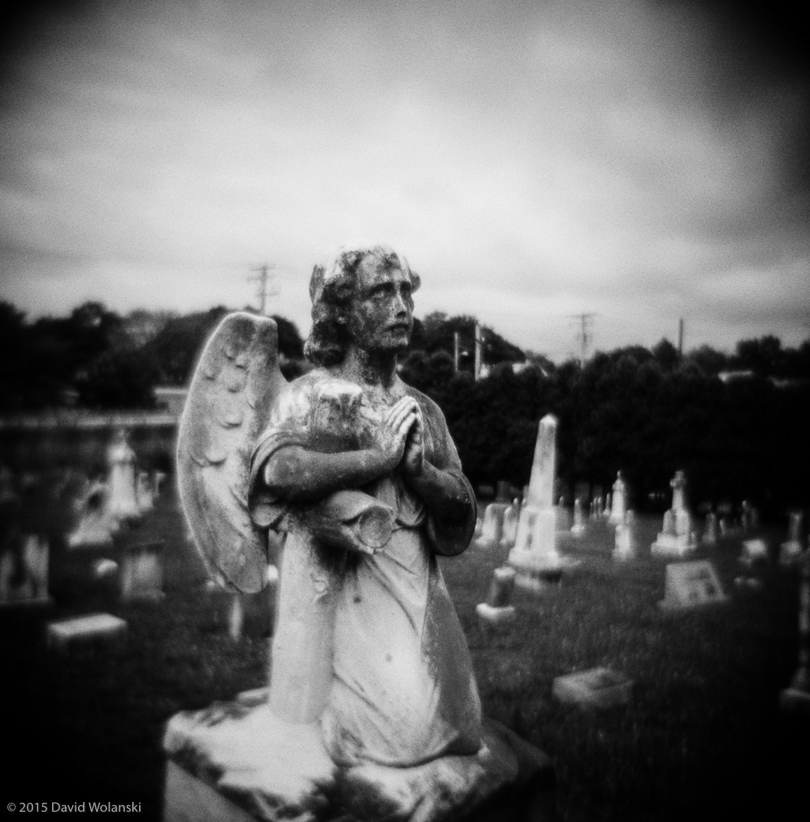 angel head stone in cemetary