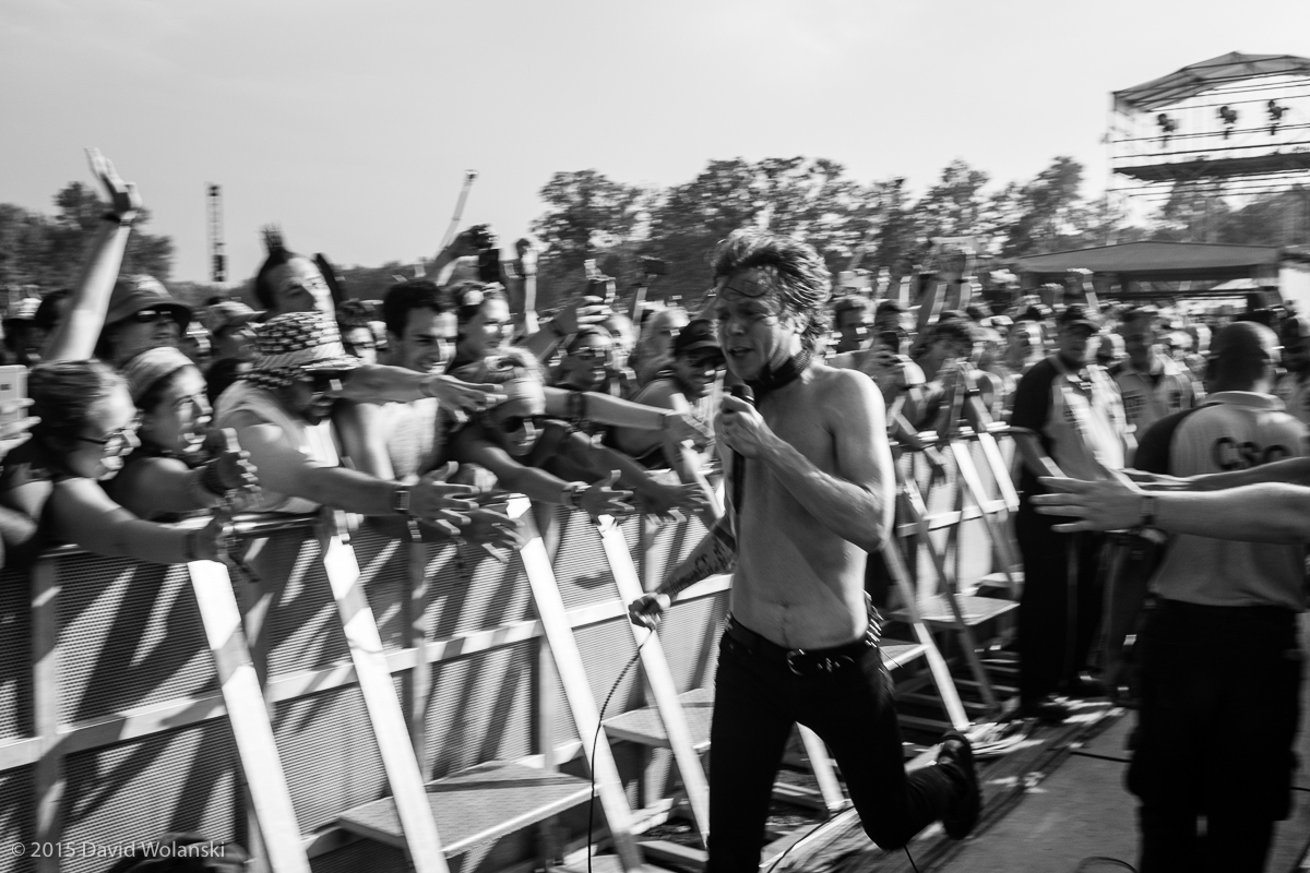Matt Shultz of Cage the Elephant at Firefly 2015 running back onstage after a foray into the crowd