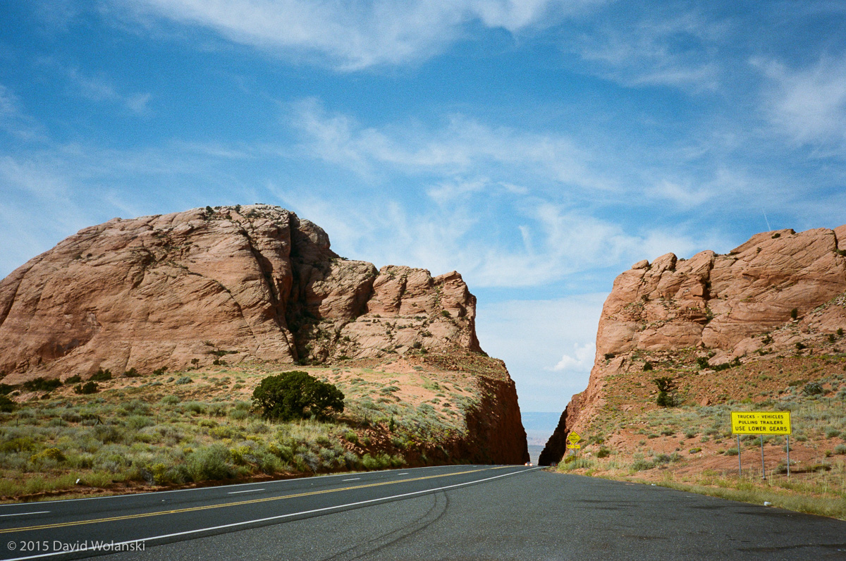 Road cut near Page Arizona. I liked the contrast between the yellow sign, blue sky and red rocks