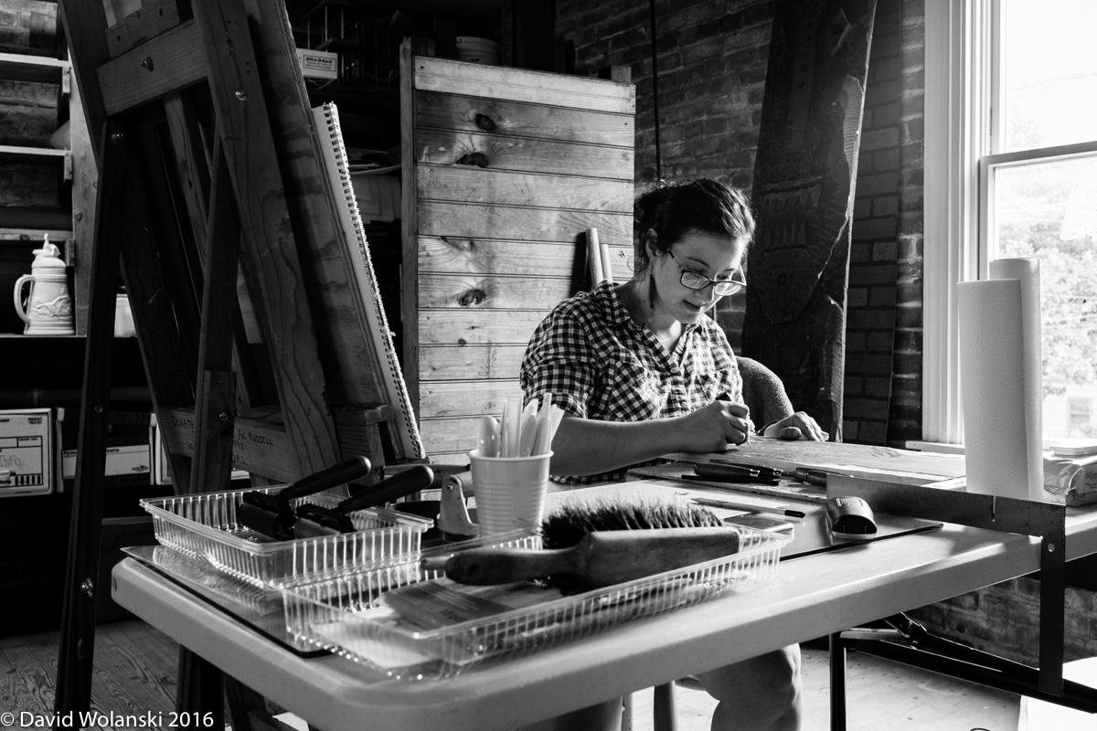 Laura Mancuso working on a wood block print