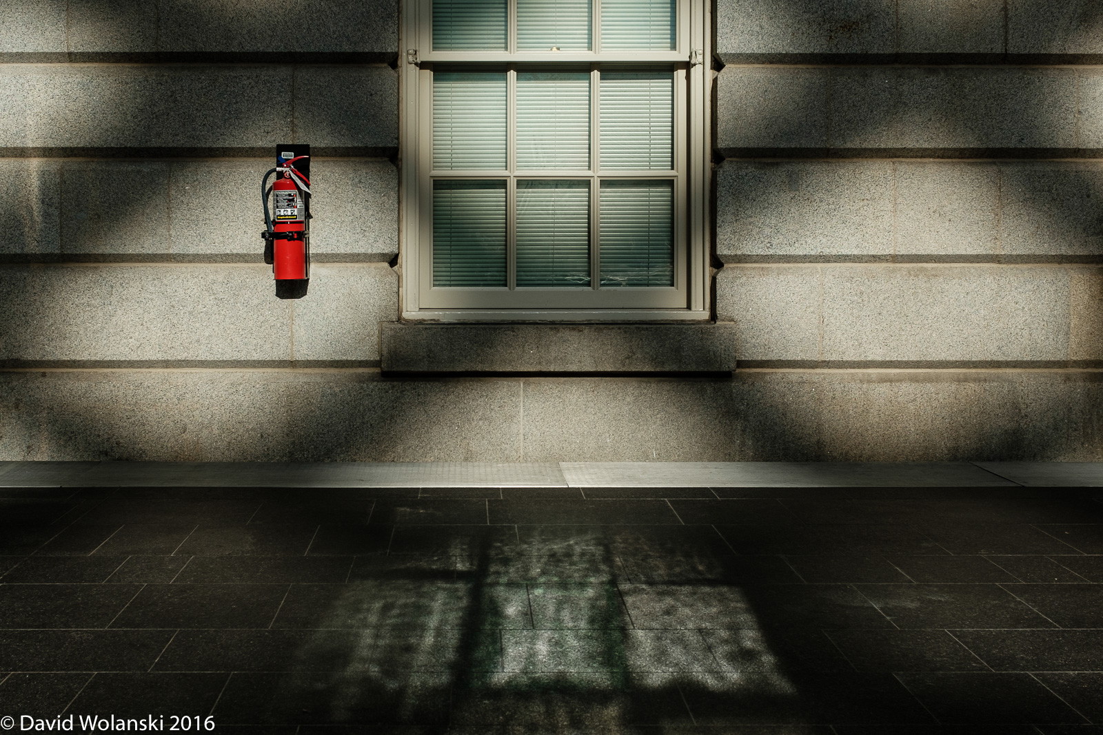 This fire extinguisher grabbed my eye in the grid, then I notice the shimmering light on the slate floor from the window. Wow!